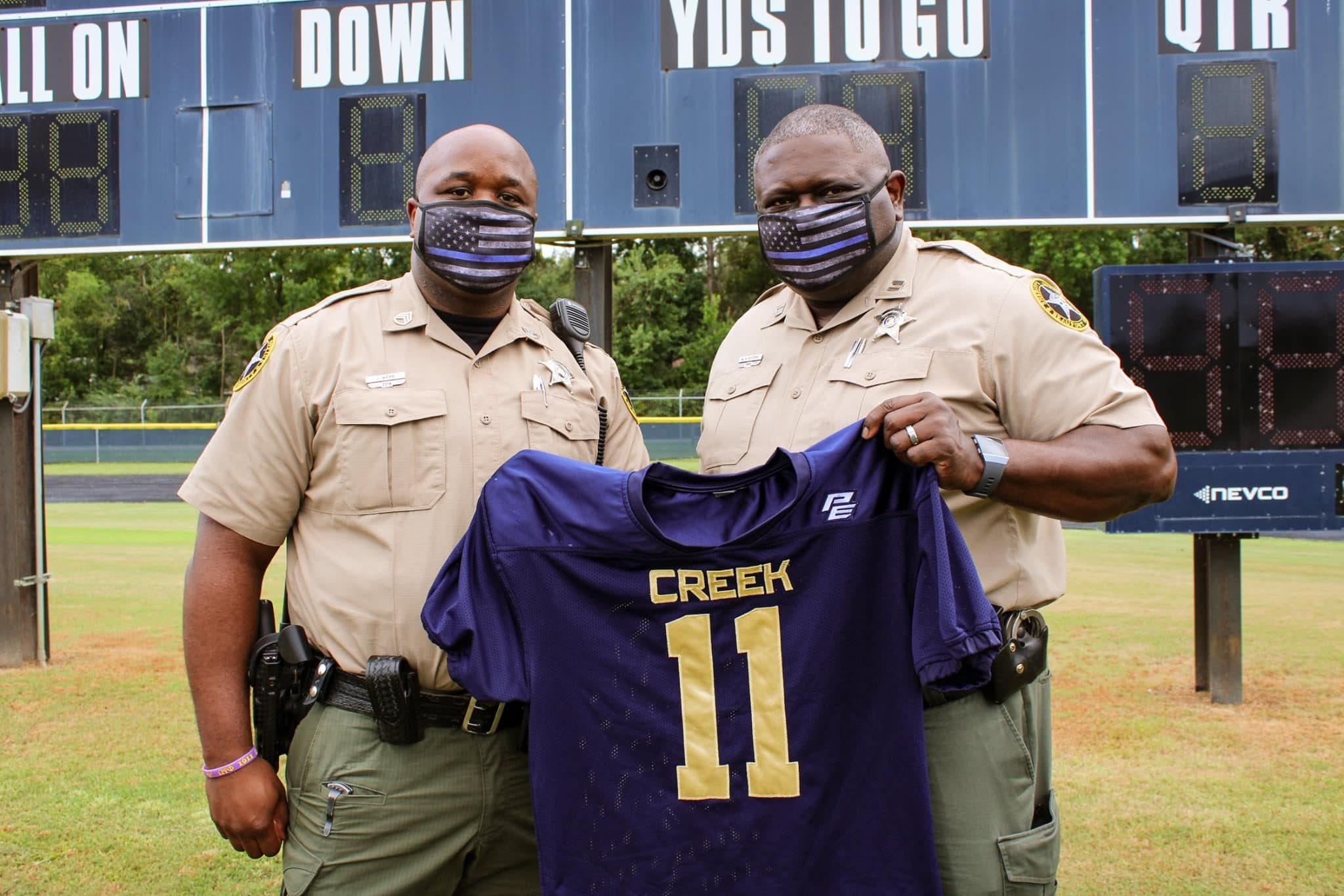 Battery Creek High School Football coaches presented Staff Sergeant Jeremiah Webb and Captain Alfredo H. Givens with a special jersey to recognize Beaufort County Sheriff's Office's continued commitment to the Dolphin students, faculty, staff and community.